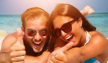 Couple with sunglasses smiling