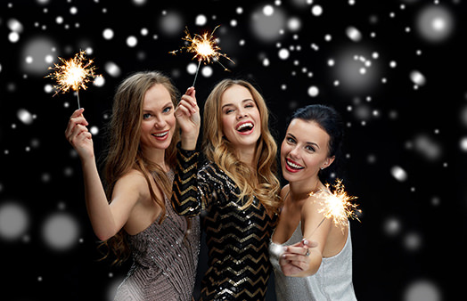 Three girls holding sparklers